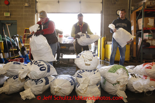 Wednesday, February 13, 2013.  Volunteers sort and stack musher Peter Kaiser's food drop bags at Airland Transport in Anchorage to be sent out to the 22 checkpoints along the trail.