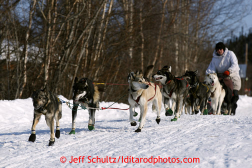 Gerry Sousa drives his team out of Shageluk and heads north on Saturday March 9, 2013. Iditarod Sled Dog Race 2013 Photo by Jeff Schultz copyright 2013 DO NOT REPRODUCE WITHOUT PERMISSION