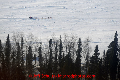 A dog team runs on the Yukon River between Eagle Island and Kaltag on Saturday March 9, 2013. Iditarod Sled Dog Race 2013 Photo by Jeff Schultz copyright 2013 DO NOT REPRODUCE WITHOUT PERMISSION