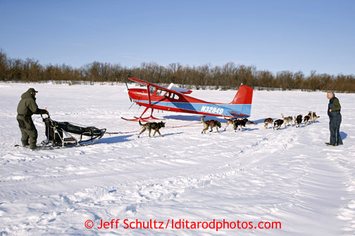 Rudy Demoski passes volunteer pilot Ed Kornfield's plane on the river after leaving Shageluk Saturday March 9, 2013.