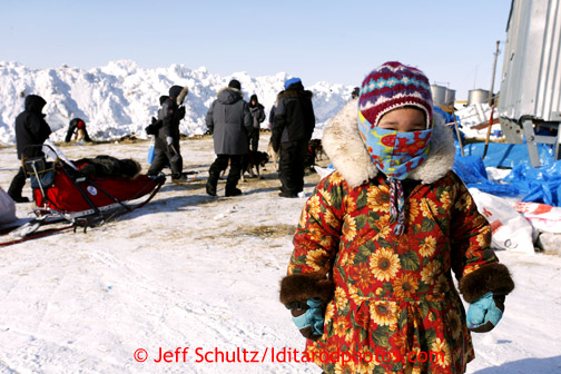 3 year old Melody Jackson watches teams resting at Shaktoolik on Monday March 11, 2013. Iditarod Sled Dog Race 2013 Photo by Jeff Schultz copyright 2013 DO NOT REPRODUCE WITHOUT PERMISSION
