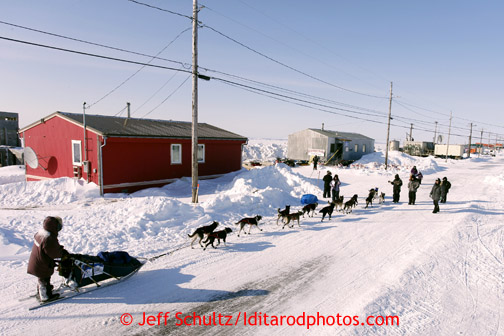 Bob Bundtzen approaches the National Guard Armory checkpoint building at Shaktoolik on Monday March 11, 2013. Iditarod Sled Dog Race 2013 Photo by Jeff Schultz copyright 2013 DO NOT REPRODUCE WITHOUT PERMISSION
