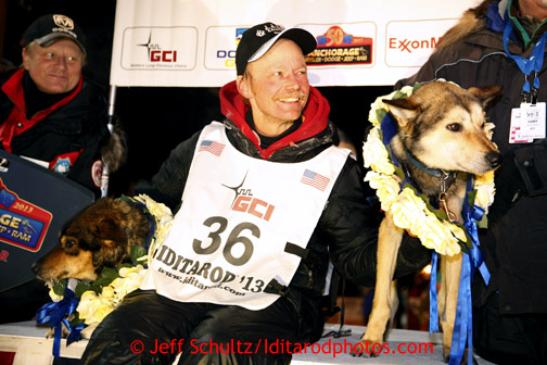 Mitch Seavey with his lead dogs Tanner, left, and Taurus after arriving in Nome first and winning his second Iditarod sled dog race on Tuesday March 12, 2013. Seavey made the journey from Willow in 9 days, 7 hours, 39 minutes, 56 seconds.  Iditarod Sled Dog Race 2013 Photo by Jeff Schultz copyright 2013 DO NOT REPRODUCE WITHOUT PERMISSION