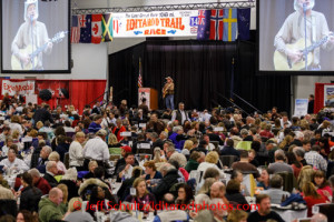 Hobo Jim enterains Iditarod fans during the dinner portion of the musher's banquet drawing at the Dena'ina  Convention Center in Anchorage