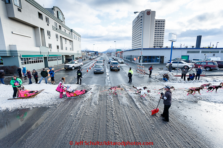 Traffic stops on 5th avenue for Iditarod musher DeeDee Jonrowe to cross in downtown Anchorage during the cermonial start day of Iditarod 2015 in Anchorage, Alaska. Saturday March 7, 2015 (C) Jeff Schultz/SchultzPhoto.com - ALL RIGHTS RESERVED DUPLICATION PROHIBITED WITHOUT PERMISSION
