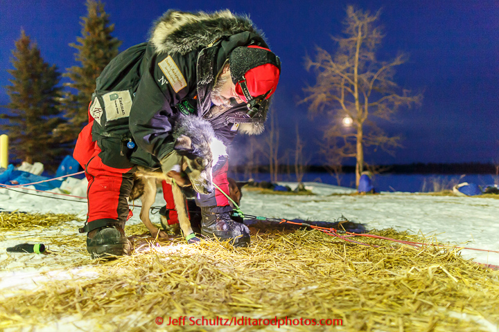 Scott Janssen boots his on the banks of the Yukon river at the Tanana checkpoint prior to departin on Wednesday morning March 11th during the 2015 Iditarod. (C) Jeff Schultz/SchultzPhoto.com - ALL RIGHTS RESERVED DUPLICATION PROHIBITED WITHOUT PERMISSION