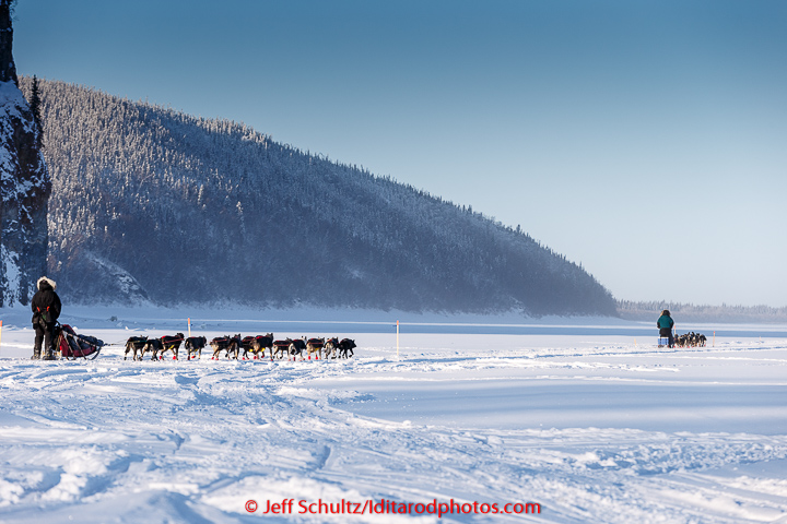 Anna Berington follows Jodi Bailey down the Yukon River in the morning on Thursday March 12, 2015 after leaving the Ruby checkpoint during Iditarod 2015. (C) Jeff Schultz/SchultzPhoto.com - ALL RIGHTS RESERVED DUPLICATION PROHIBITED WITHOUT PERMISSION