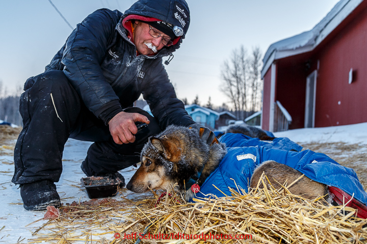 Mitch Seavey sprays an essential oil on one of his dogs in the morning on Thursday March 12, 2015 at the Ruby checkpoint during Iditarod 2015. (C) Jeff Schultz/SchultzPhoto.com - ALL RIGHTS RESERVED  DUPLICATION  PROHIBITED  WITHOUT  PERMISSION