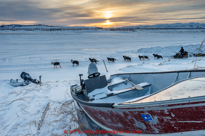 Curt Perano runs out of the Unalakleet checkpoint at sunrise on Tuesday March 16, 2015 during Iditarod 2015. (C) Jeff Schultz/SchultzPhoto.com - ALL RIGHTS RESERVED DUPLICATION PROHIBITED WITHOUT PERMISSION