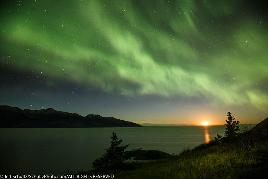 Autum/Fall landscape of Northern Lights (Aurora Borealis) over Turnagain Arm and and Kenai Mountains as a near-full moon sets on the horizon. SouthCentral, Alaska Photo by Jeff Schultz/SchultzPhoto.com (C) 2016 ALL RIGHTS RESVERVED