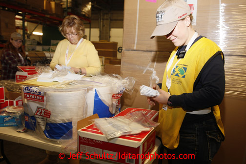 Friday, February 15, 2013.   Volunteers Pat Hanson (L) and Sister Marissa Hedelius (from the LDS church Helping Hands Ministry) count forks to be sent out to the 22 checkpoints along the Iditarod trail at Airland Transport in Anchorage.