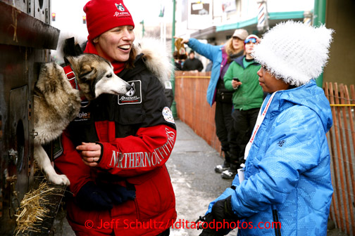 Aliy Zirkle talks to 9 year old Adara Clemons in the staging area prior to the ceremonial start of the Iditarod sled dog race in downtown Anchorage Saturday, March 2, 2013.  Photo (C) Jeff Schultz/IditarodPhotos.com  Do not reproduce without permission