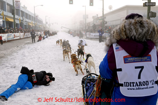 Michelle Phillips leaves the start line on 4th avenue in the fog during the ceremonial start of the Iditarod sled dog race in downtown Anchorage Saturday, March 2, 2013.  Photo (C) Jeff Schultz/IditarodPhotos.com  Do not reproduce without permission