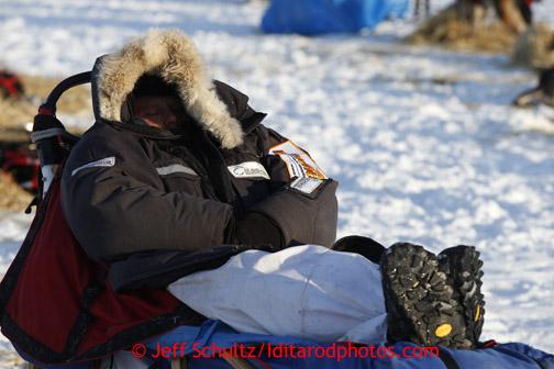 Ramey Smyth sleeps on his sleep at the Nikolai checkpoint March 5, 2013.