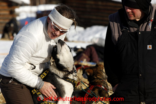 Veterinarian Julie Kittams, left, and Gerald Soua's dog Mar at the Shageluk checkpoint on Saturday March 9, 2013.