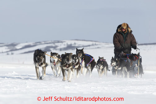 Sonny Lindner passes a race marker as he heads into the Unalakleet checkpoint on Sunday March 10, 2013. Iditarod Sled Dog Race 2013 Photo by Jeff Schultz copyright 2013 DO NOT REPRODUCE WITHOUT PERMISSION