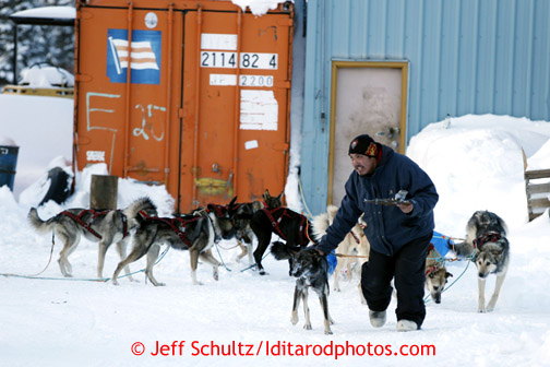 Carl Paul leads Jeff King's team into the Elim checkpoint on Monday March 11, 2013. Iditarod Sled Dog Race 2013 Photo by Jeff Schultz copyright 2013 DO NOT REPRODUCE WITHOUT PERMISSION