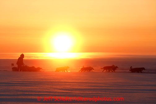 Paul Gebhart on the Bering Sea at sunrise after leaving the Elim checkpoint on Tuesday March 12, 2013. Iditarod Sled Dog Race 2013 Photo by Jeff Schultz copyright 2013 DO NOT REPRODUCE WITHOUT PERMISSION