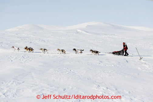 Aily Zirkle races near Cape Nome between White Mountain and Safety on Tuesday March 12, 2013. Iditarod Sled Dog Race 2013 Photo by Jeff Schultz copyright 2013 DO NOT REPRODUCE WITHOUT PERMISSION