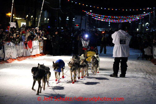 Mitch Seavey drives his team down Front Street in Nome first and winning his second Iditarod sled dog race on Tuesday March 12, 2013. Seavey made the journey from Willow in 9 days, 7 hours, 39 minutes, 56 seconds.  Iditarod Sled Dog Race 2013 Photo by Jeff Schultz copyright 2013 DO NOT REPRODUCE WITHOUT PERMISSION