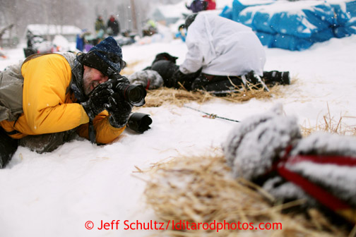 Jeff Shultz photographs dog teams in the snow in Takotna Wednesday, March 6, 2013.