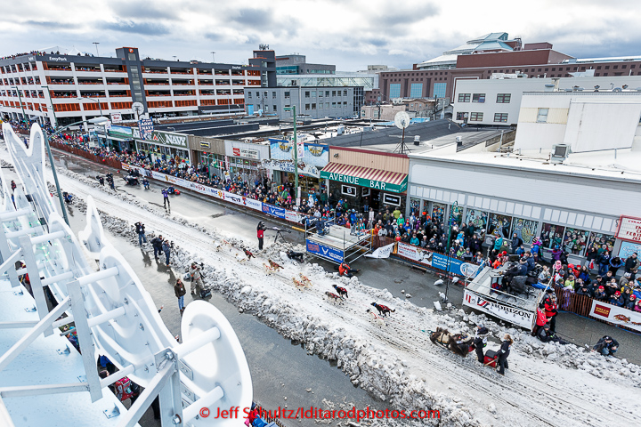 Scott Janssen runs down 4th avenue during the cermonial start day of Iditarod 2015 in Anchorage, Alaska. Saturday March 7, 2015 (C) Jeff Schultz/SchultzPhoto.com - ALL RIGHTS RESERVED  DUPLICATION  PROHIBITED  WITHOUT  PERMISSION