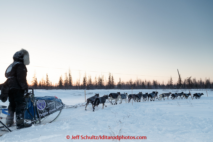 Jessie Royer runs through the checkpoint in Manley on Tuesday March 10, 2015 This is the second checkpoint of the 2015 Iditarod. (C) Jeff Schultz/SchultzPhoto.com - ALL RIGHTS RESERVED DUPLICATION PROHIBITED WITHOUT PERMISSION