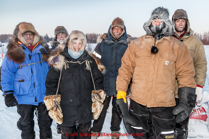 The volunteer pit crew poses for a photo .in the morning at the checkpoint in Manley on Tuesday March 10, 2015.  This is the second checkpoint of the 2015 Iditarod. (C) Jeff Schultz/SchultzPhoto.com - ALL RIGHTS RESERVED  DUPLICATION  PROHIBITED  WITHOUT  PERMISSION