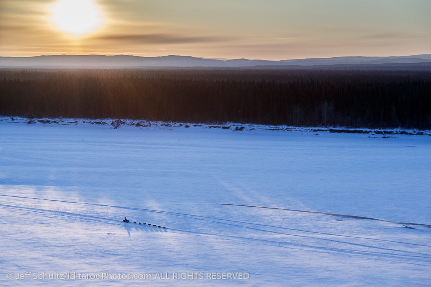 A team runs down the Yukon River as the sun rises near the  Galena checkpoint on Friday March 13, 2015 during Iditarod 2015.   (C) Jeff Schultz/SchultzPhoto.com - ALL RIGHTS RESERVED  DUPLICATION  PROHIBITED  WITHOUT  PERMISSION