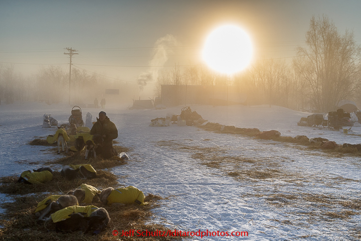 Mats Petterson boots his dogs in the ice fog at 40 below zero in the morning at the Huslia checkpoint on Saturday  March 14, 2015 during Iditarod 2015.   (C) Jeff Schultz/SchultzPhoto.com - ALL RIGHTS RESERVED  DUPLICATION  PROHIBITED  WITHOUT  PERMISSION