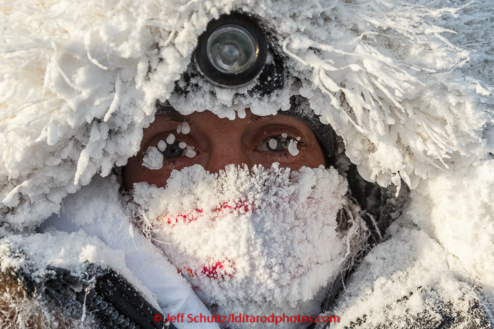 Kristi Berington is frosted up after a 40 below zero run into the Huslia checkpoint on Saturday  March 14, 2015 during Iditarod 2015.   (C) Jeff Schultz/SchultzPhoto.com - ALL RIGHTS RESERVED  DUPLICATION  PROHIBITED  WITHOUT  PERMISSION