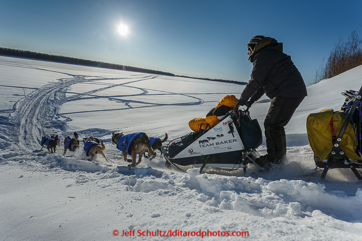 Katherine Keith runs down the bank onto the Koyukuk River after leaving the Huslia checkpoint on Saturday  March 14, 2015 during Iditarod 2015.   (C) Jeff Schultz/SchultzPhoto.com - ALL RIGHTS RESERVED  DUPLICATION  PROHIBITED  WITHOUT  PERMISSION