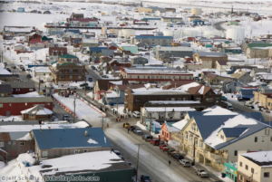 Aerial view of a crowd gathered around Matt Calore in the finish chute Nome's Front Street on Friday afternoon during Iditarod 2008<br /> Photo by Jeff Schultz/SchultzPhoto.com (C) 2018 ALL RIGHTS RESERVED
