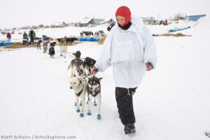 Musher Melissa Owens helps guide Silvia Willis' team out of the Unalakleet checkpoint on Monday during Iditarod 2008 Photo by Jeff Schultz/SchultzPhoto.com (C) 2018 ALL RIGHTS RESERVED