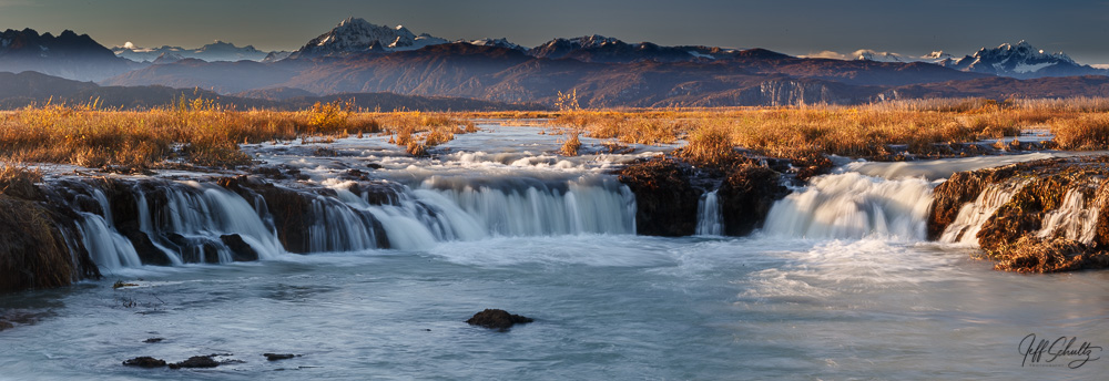 Fall Landscape of waterfalls with Alaska Range background Alaska.
