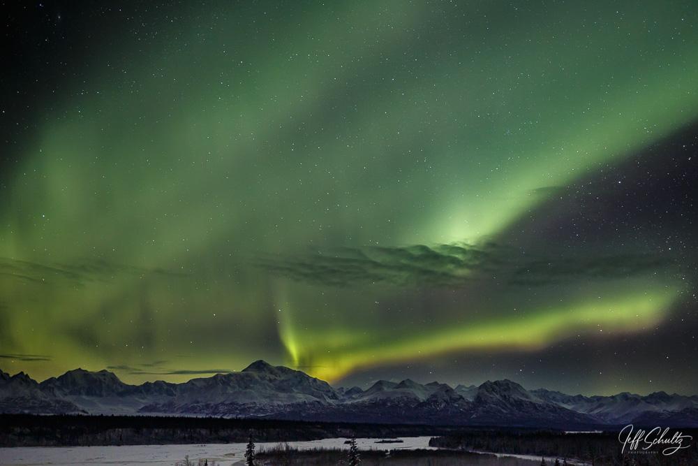 Winter landscape of Northern Lights (Aurora Borealis) over the southside of Denali and the Alaska Range