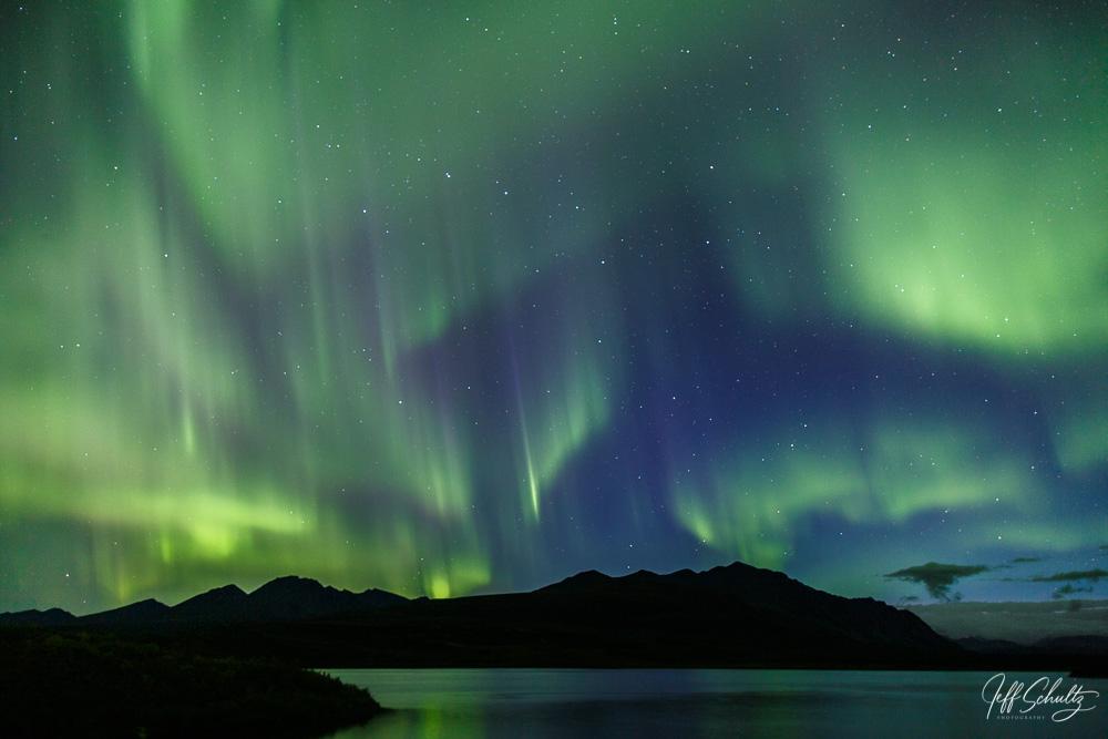Fall landscape of Northern lights over Tangle Lake along the Denali Highway Southcentral, Alaska